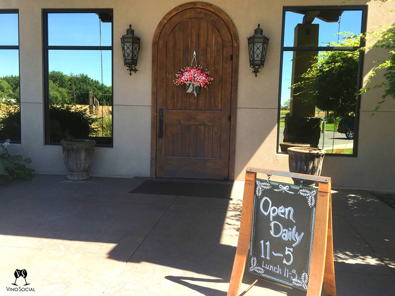 Chalkboard hours and entry County Line Tasting Room